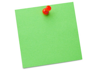 Green post-it with drawing pin