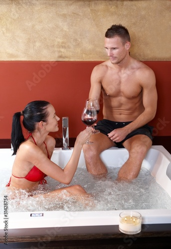 Couple having fun in jacuzzi