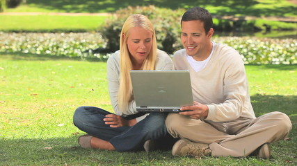 Young couple on their laptop