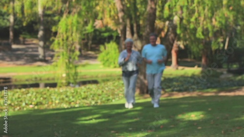 Mature couple running outdoors