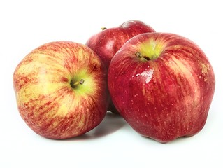 Three fresh red apples on white background