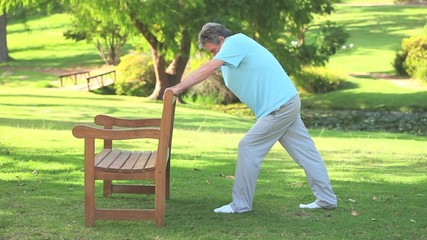 Mature man doing his stretches outdoors