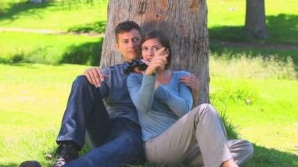 Young couple watching something through binoculars