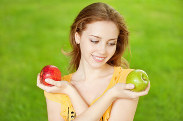 beautiful girl with apples