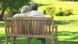 Mature couple sitting talking outdoors