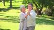 Mature couple dancing outside