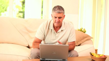 Man exasperated with his laptop