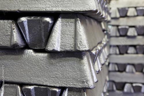Leinwandbild Motiv buffer stock of aluminum bars