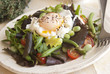 Bean and tomato salad with poached egg