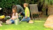 Family doing some gardening on lawn