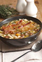Tuscan soup with crispy bacon and beans