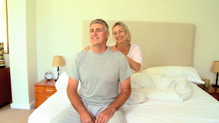 Young  woman giving her husband a massage