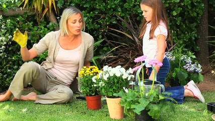 Young girl and mother doing some gardening