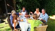 Family barbecue meal in the garden