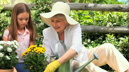 Grandmother and girl doing some gardening