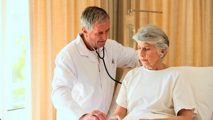 Doctor examining woman patient