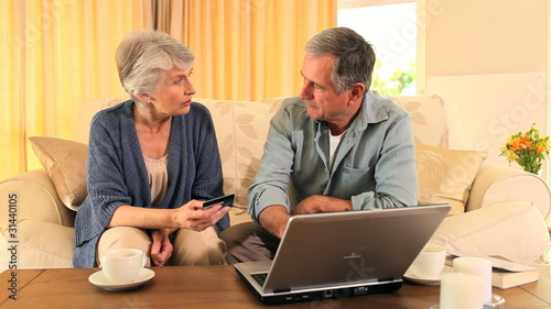 Senior couple making a payment on the internet