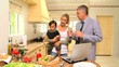 Parents talking in kitchen while mother holds baby