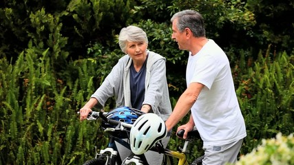 Mature couple with two bikes
