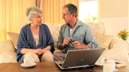 Mature couple using a credit card