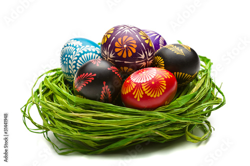 Easter Eggs in Nest on Green
