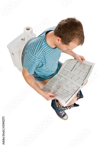 man is sitting on toilet