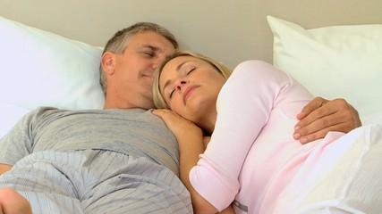 Relaxed couple sleeping