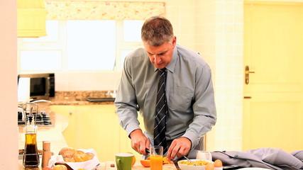 Businessman taking a quick breakfast