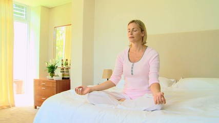 Woman doing the lotus position