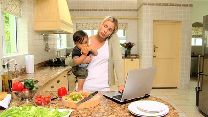 Mother carrying her son in kitchen