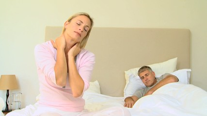 Blonde haired woman having a neck pain