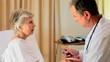 Mature doctor visiting an elderly woman