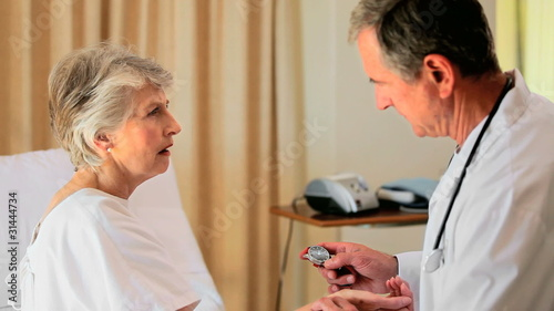 Mature doctor visiting an elderly woman