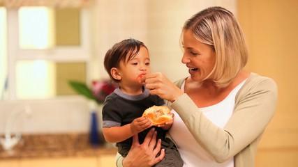 Mother feeding her toddler