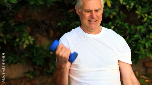 Mature man exercising his arms