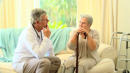Doctor  with his patient discussing her condition