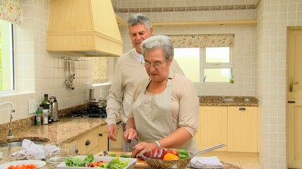 Mature couple cooking together