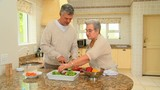 Mature couple preparing vegetables