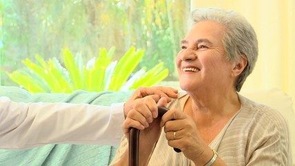 Doctor encouraging a mature female patient