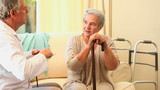 A mature patient and her doctor talking