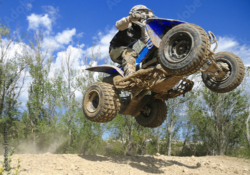 Foto op Plexiglas Motorsport blue quad jumping