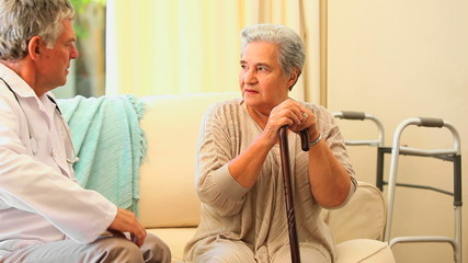 Doctor visiting a worried older  patient