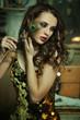 Beauty brunette in gold dress