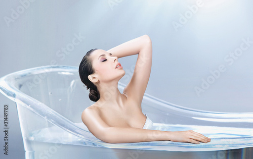 Perfect beauty in a bathtub of glass