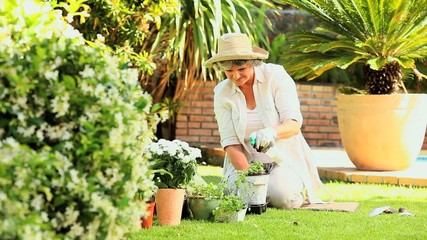 Retired woman working in her garden