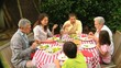 Family lunch with grandparents in the garden
