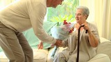 Man bringing  a bunch of flowers to his wife in hospital