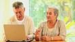 Retired couple using a laptop