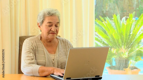 Mature woman using a laptop