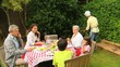 Three generations of a family having a barbecue